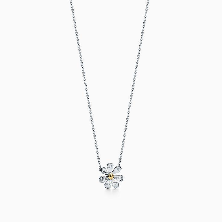 Return to Tiffany™ Love Bugs:Colgante de margarita en plata de ley y oro de 18 ct