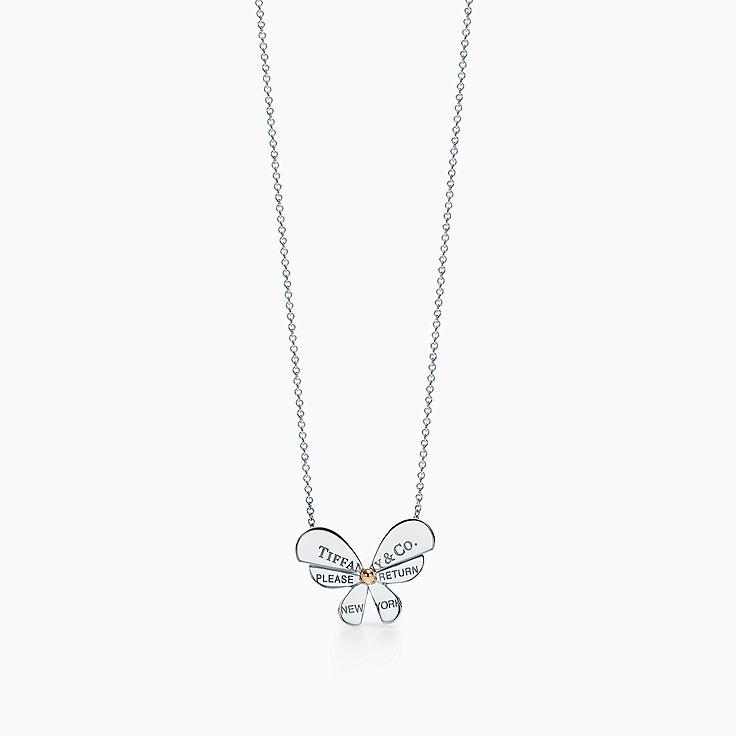 Return to Tiffany™ Love Bugs:Colgante de mariposa en plata de ley y oro rosa de 18 ct