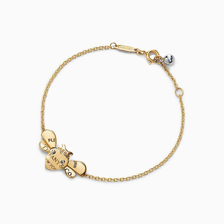 Return to Tiffany™ Love Bugs:Pulsera de cadena con abeja en oro de 18 ct y plata de ley