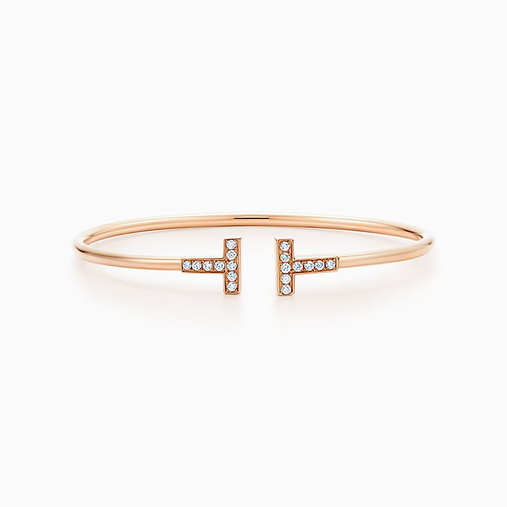 https://media.tiffany.com/is/image/Tiffany/EcomBrowseM/tiffany-t-wire- bracelet-33263538_991774_AV_1_M.jpg?op_usm=2.00,1.00,6.00&defaultImage= ...