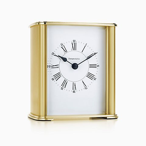 Rectangular mantel clock in brass.
