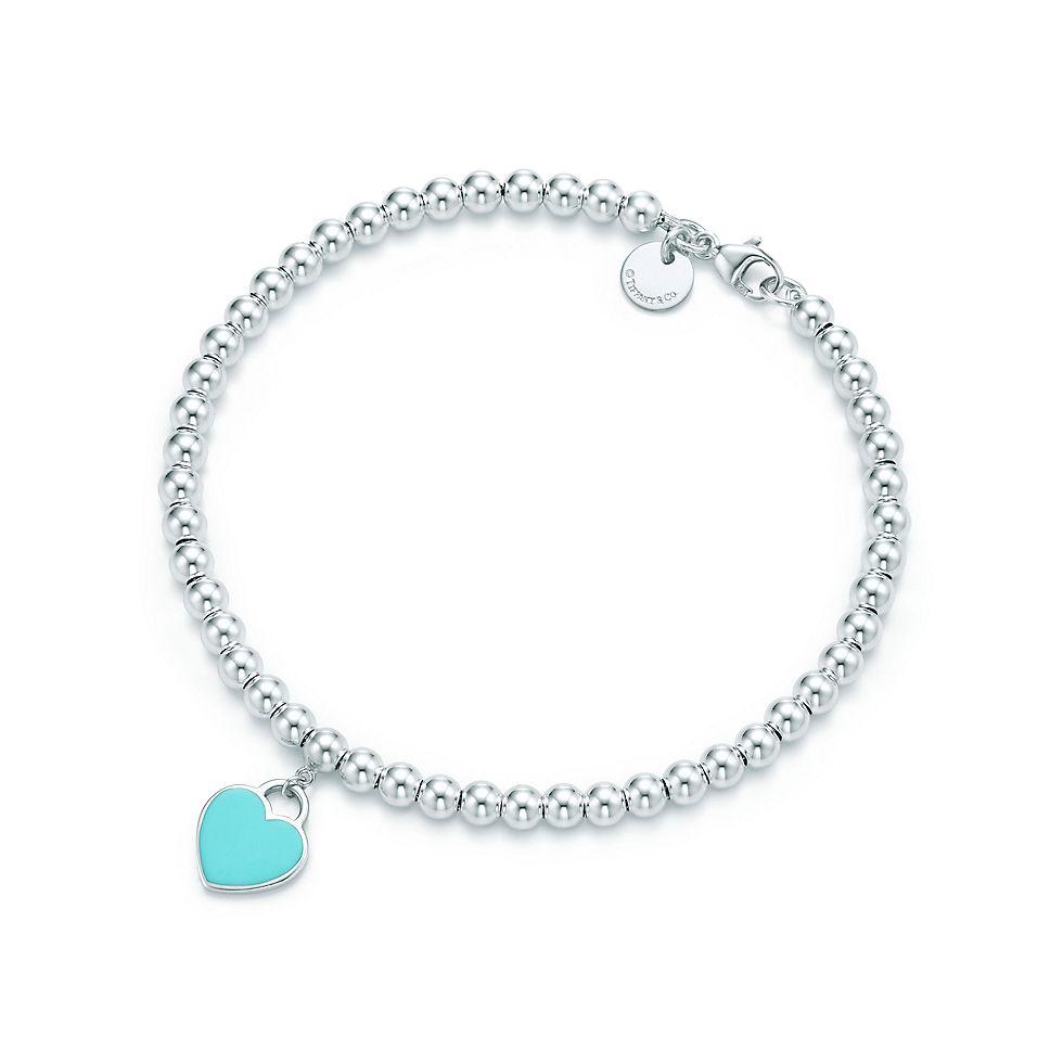 Ciondolo a cuore mini in argento su bracciale bead. Return To Tiffany™