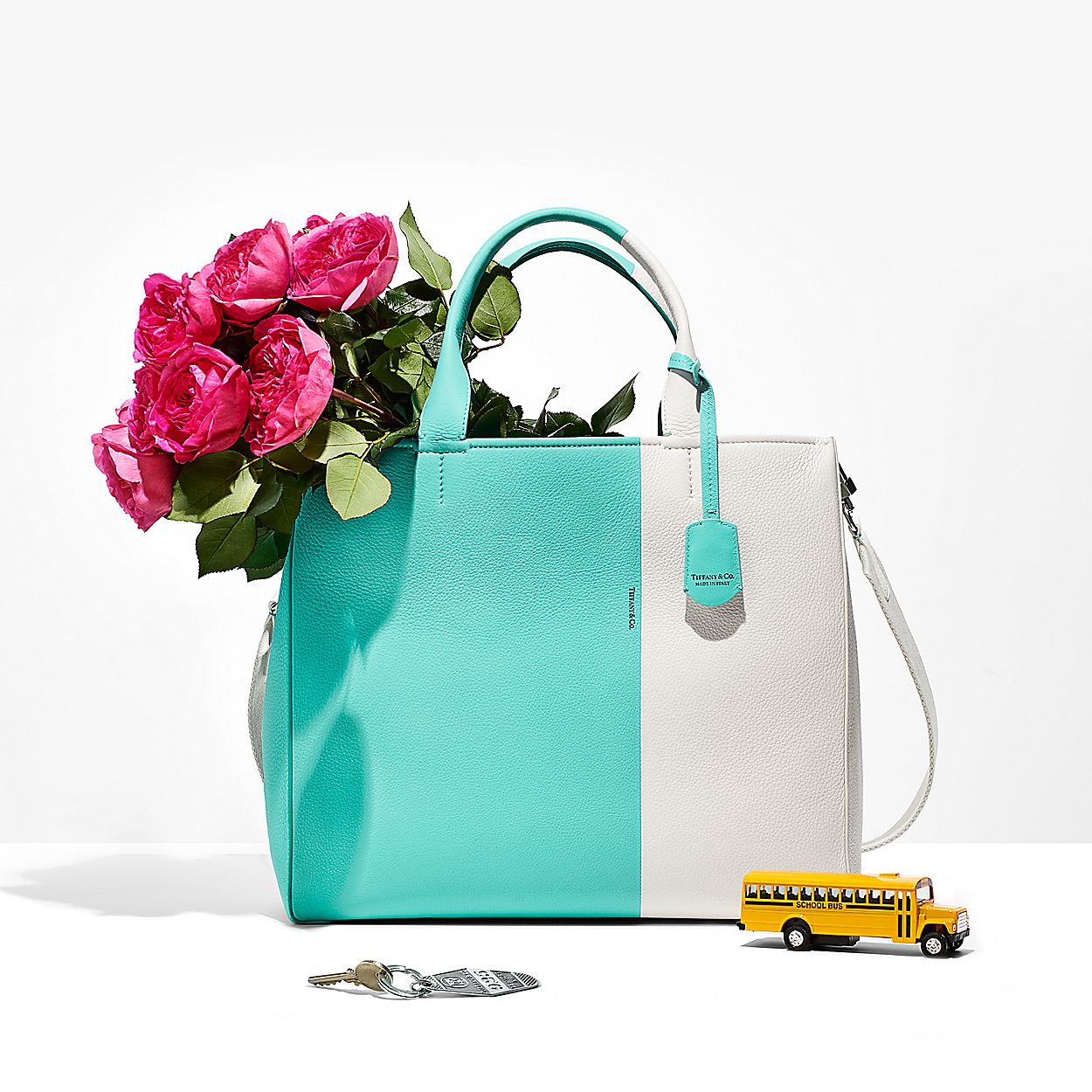 0e0548b844a Color Block women s tote in off-white and Tiffany Blue® grain ...