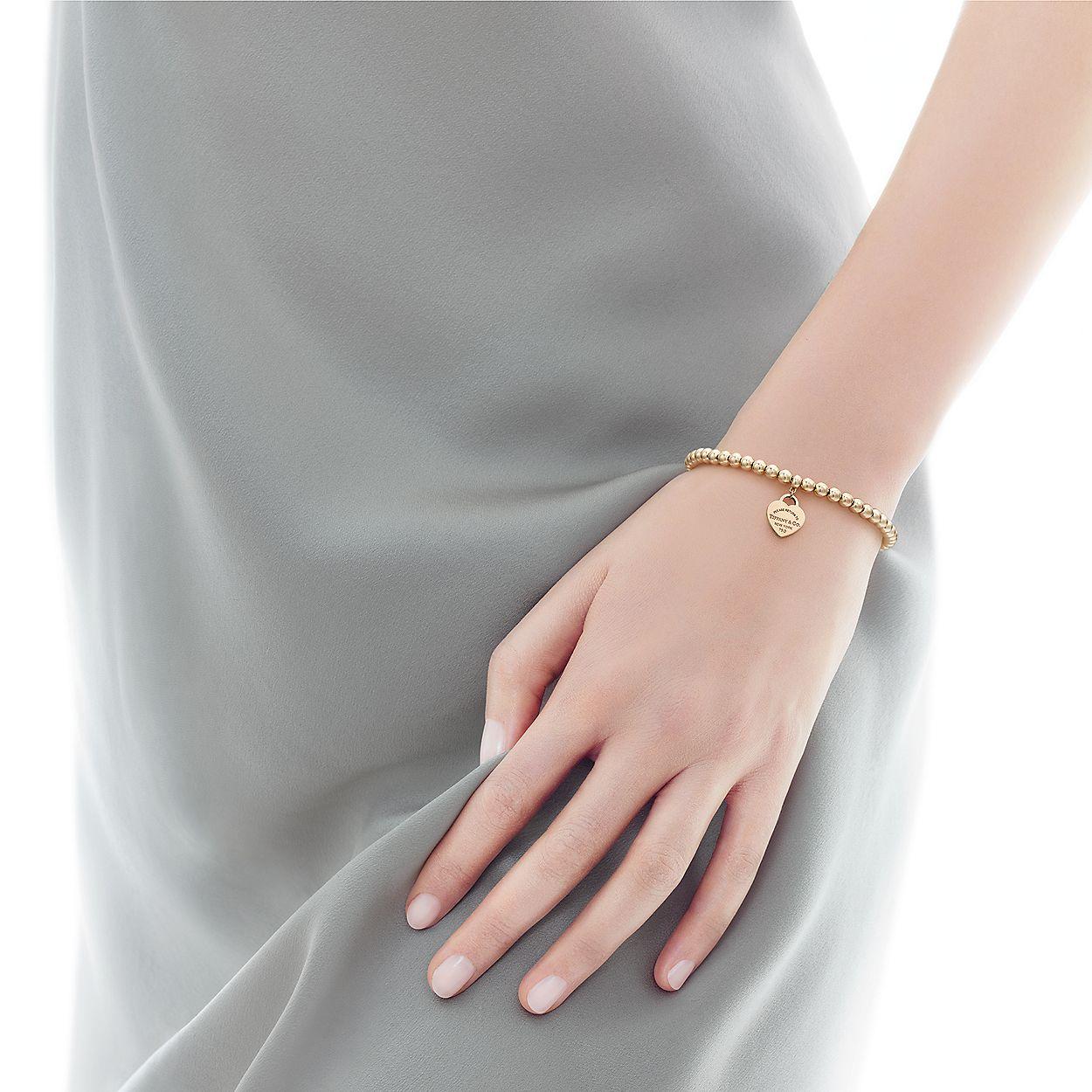 c0b2664728a Return to Tiffany® mini heart tag in 18k gold on a bead bracelet ...