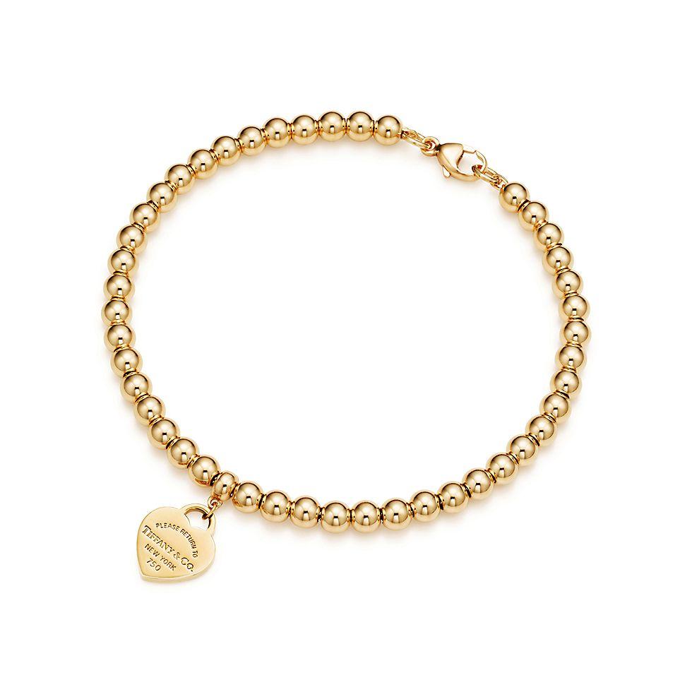 36d688b2bb2eb Return to Tiffany® mini heart tag in 18k gold on a bead bracelet. | Tiffany  & Co.