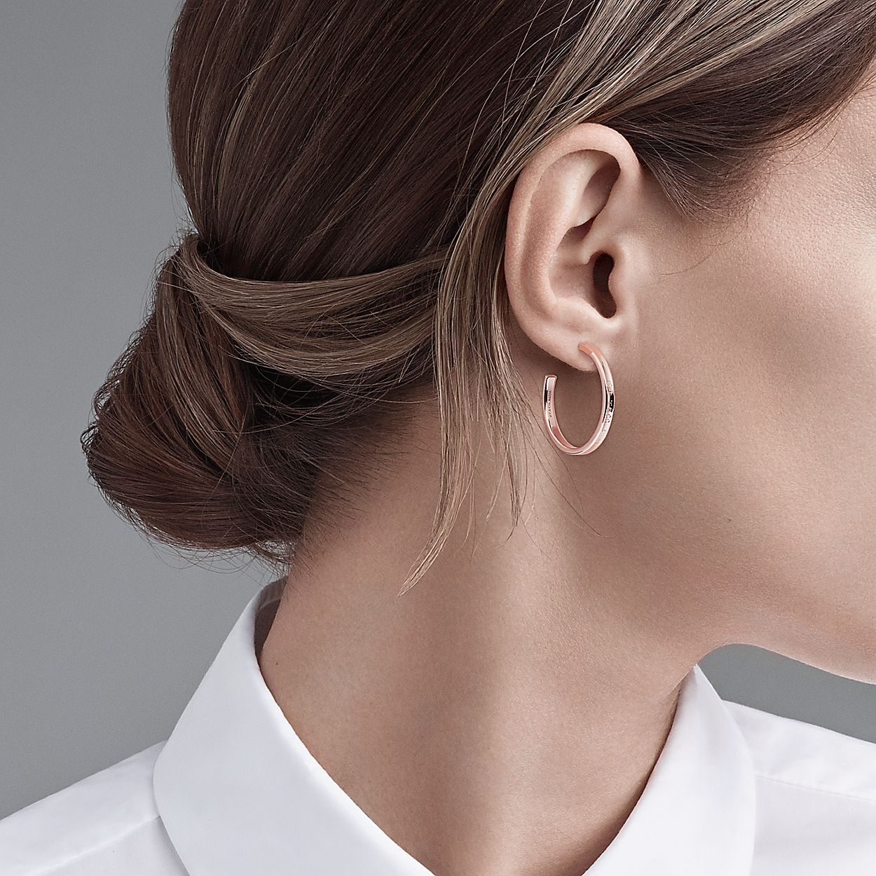 d86f9f347 Tiffany 1837® hoop earrings in Rubedo® metal. | Tiffany & Co.