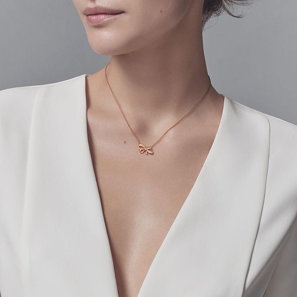 a42783eea Tiffany Bow ribbon pendant in 18k rose gold with round brilliant diamonds,  mini.   Tiffany & Co.