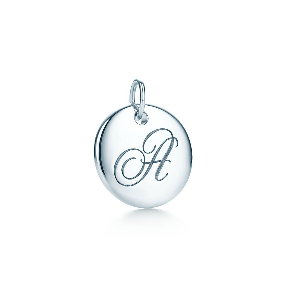 7ce51e483 Tiffany Notes alphabet disc charm in silver, small. Letters A-Z available.  | Tiffany & Co.