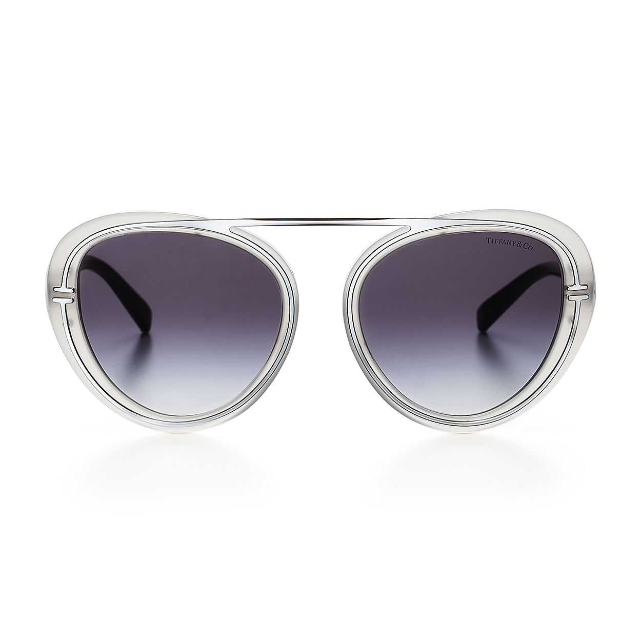 7e93bb66e637 Tiffany T round sunglasses in silver-colored metal.