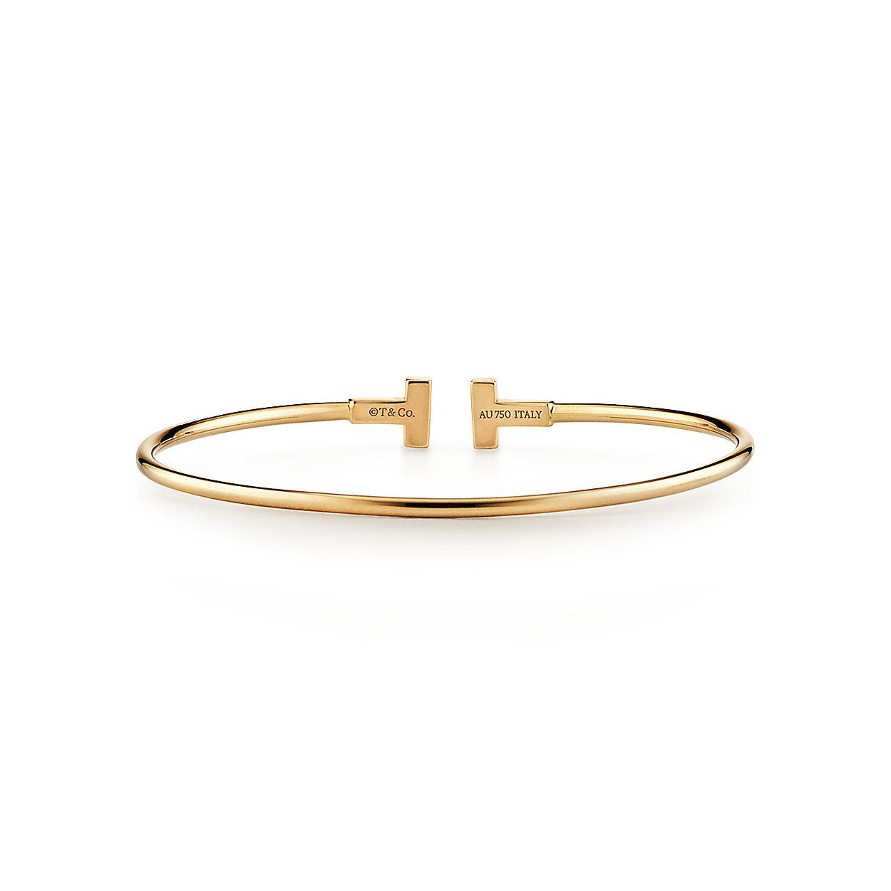 a7ebb73e8 Tiffany T narrow wire bracelet in 18k gold, medium. | Tiffany & Co.