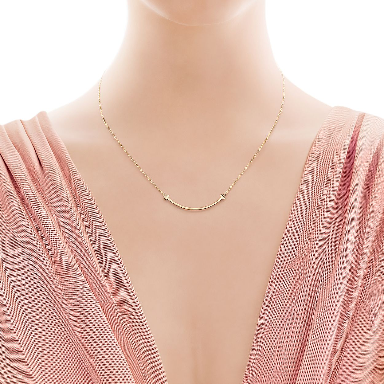 81c5e4113 Tiffany T smile pendant in 18k gold, mini.   Tiffany & Co.