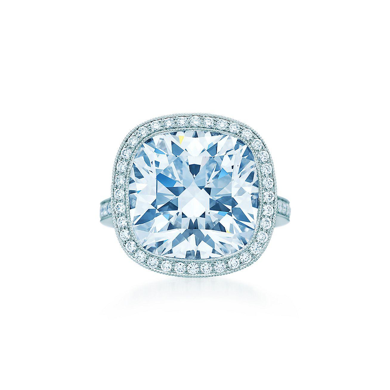 Cushion Cut Diamond Ring In Platinum With Round Brilliant Diamonds