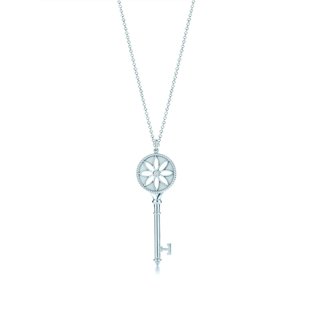Tiffany keys daisy key pendant in 18k white gold with a diamond on a tiffany keysdaisy key pendant aloadofball Images
