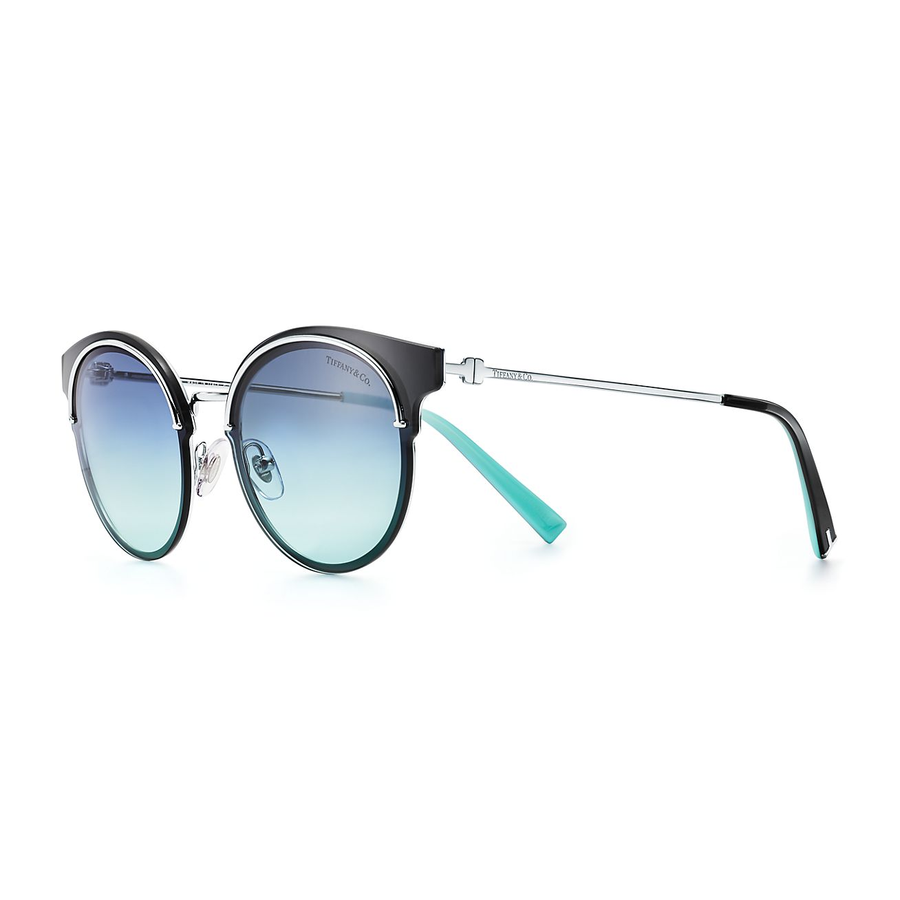 aad27b94e4ec Tiffany T round sunglasses in silver-colored metal.
