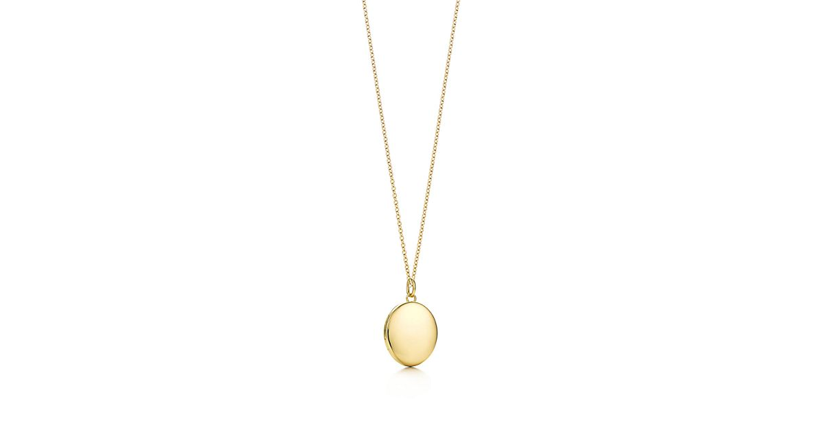 Oval locket pendant in 18k gold medium tiffany co aloadofball