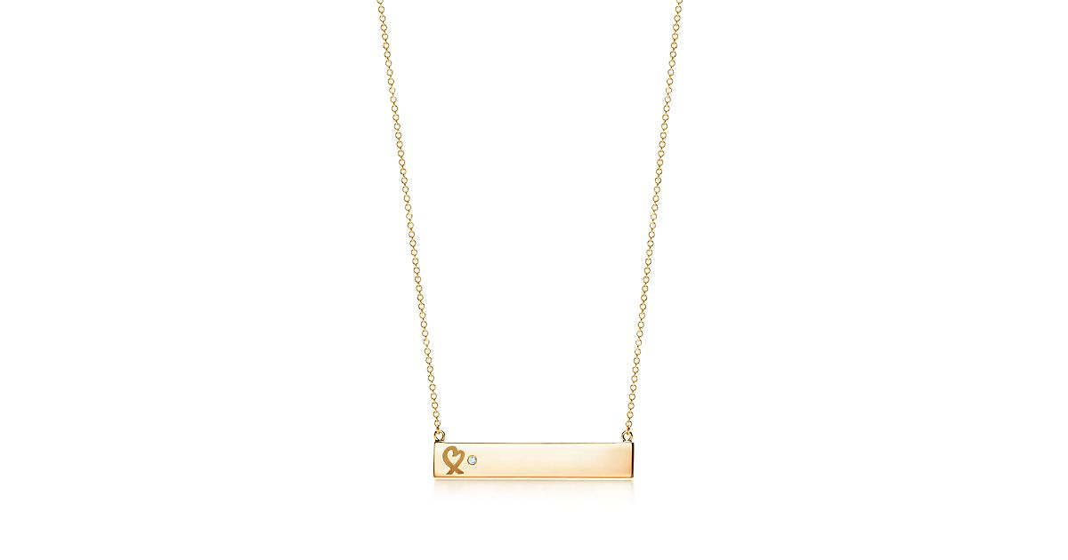 Paloma Picasso Loving Heart bar pendant in 18k gold with a diamond Tiffany & Co. tapOs6