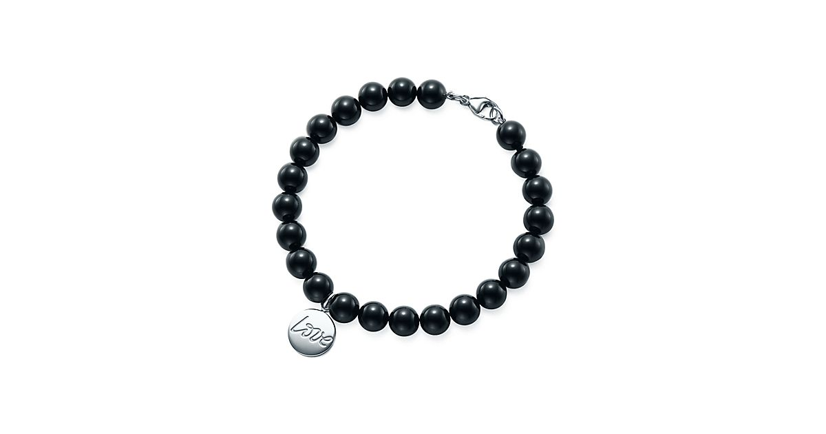 Palomas Graffiti love tag in sterling silver on an onyx bead bracelet, medium Tiffany & Co.