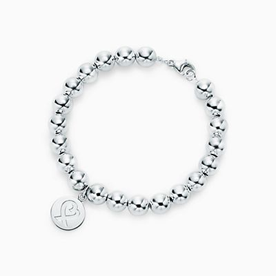Palomas Graffiti peace tag in sterling silver on a bead bracelet, small Tiffany & Co.
