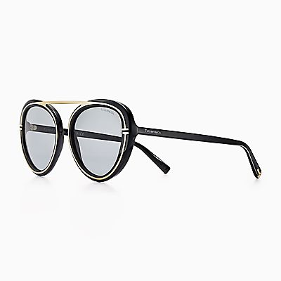 e8242117e5 Tiffany T aviator sunglasses in black acetate and pale gold-coloured metal.