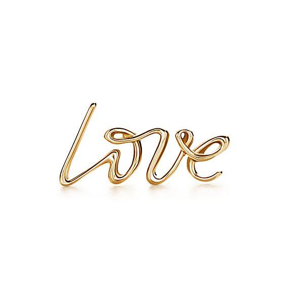 Paloma's Graffiti love single earring in 18k gold.