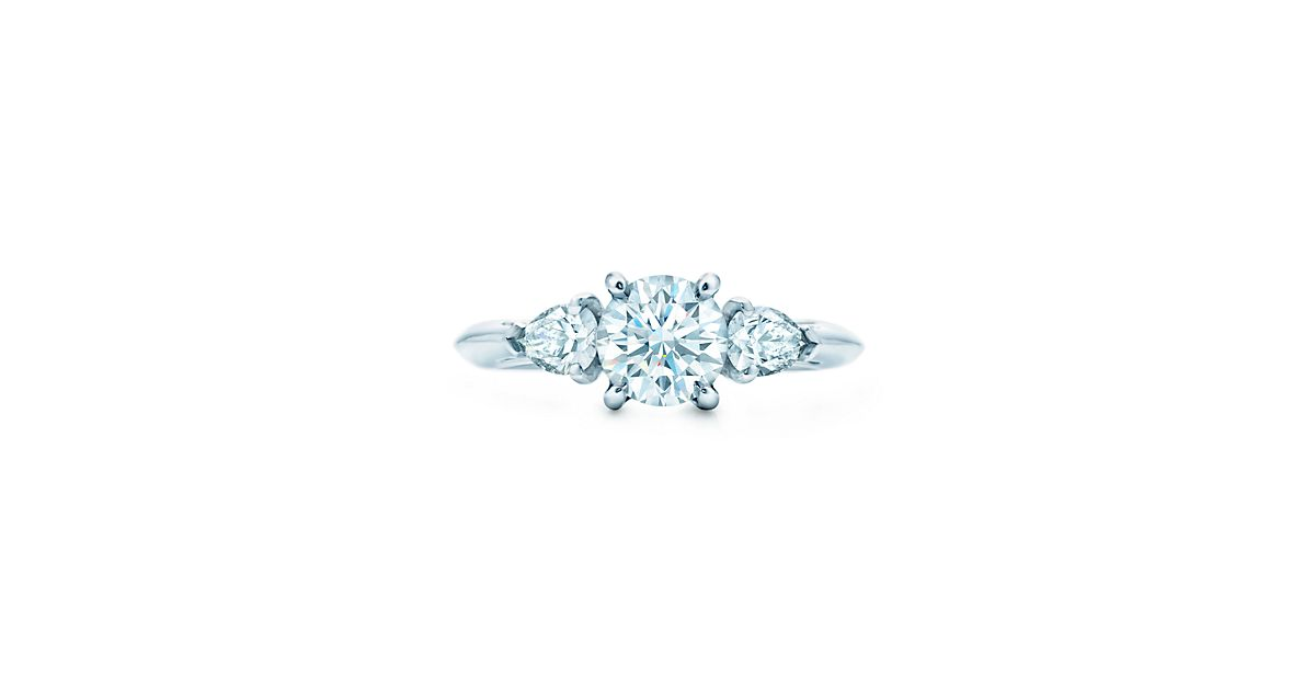 Round Brilliant Diamond With Pear Shaped Side Stones Engagement